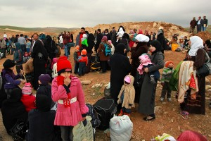 Syrian refugees and their families rest after crossing from Syria into Jordan near Mafraq, to escape violence in Syria, February 18, 2013.  REUTERS/Muhammad Hamed